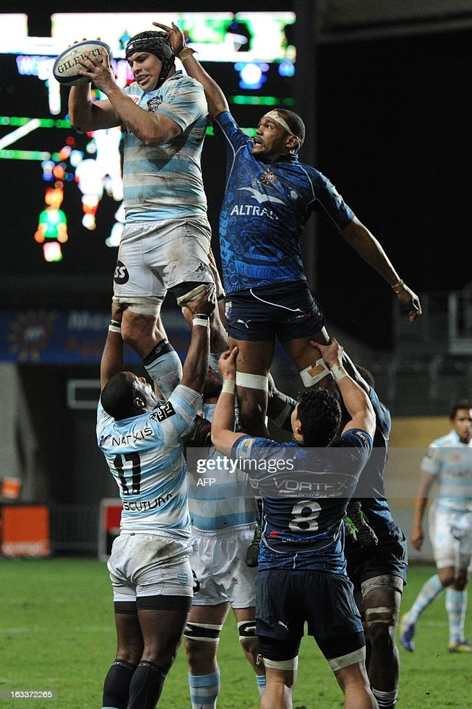Racing Metro's Francois Van Der Merwe (L) grabs the ball in a line-out with Montpellier's Alexandre Bias (R) during the French Top 14 rugby Union match Montpellier vs Racing Metro on March 8, 2013 at the Yves du Manoir stadium in Montpellier, southwestern France.