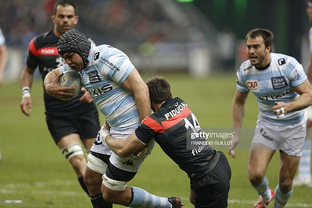 Racing Metro's Francois Van der Merwe (L) is tackled by Toulouse's wing Vincent Clerc (R) during the French Top 14 rugby union match on March 30, 2013 at the Stade de France in Saint-Denis, near Paris. AFP PHOTO / FRANCOIS GUILLOT
