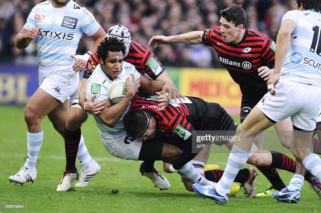 Racing Metro's Full Back Benjamin Fall (C) is tackled by Saracens' number 8 Joubert Ernst during an European Cup rugby union match between Racing Metro and Saracens on January 12, 2013 at the La Beaujoire Stadium in Nantes, western France. AFP PHOTO / JEAN-SEBASTIEN EVRARD