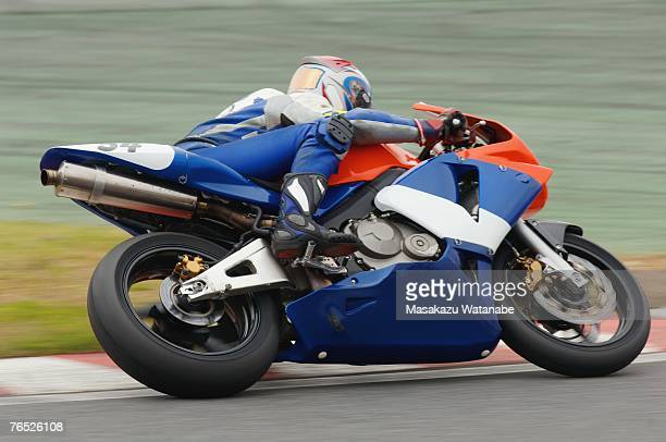 Racing motor bike cornering