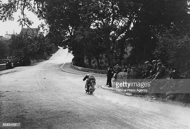 Racing motorcyclist W Newsome riding a Triumph in the Senior Tourist Trophy at the Isle Of Man TT races 5th July 1911