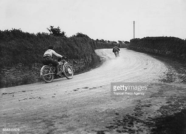 Racing motorcyclists C B Franklin riding an Indian and K Gassert on an NSU competing in the Senior Tourist Trophy at the Isle Of Man TT races 5th...