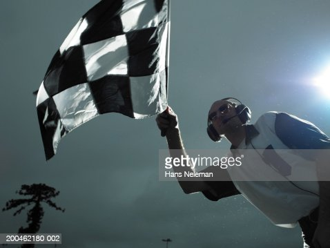 Racing official waving checkered flag : Stock Photo