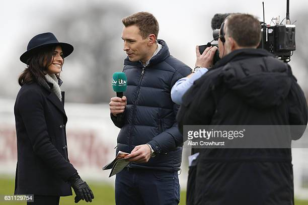 Racing presenters Ollie Bell chats with weather girl Lucy Verasamy at Sandown Park on January 7 2017 in Esher England