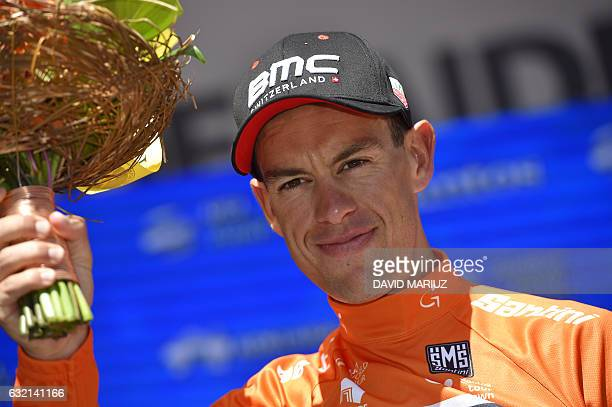 BMC Racing rider and overall leader Richie Porte of Australia poses on the podium after stage four of the Tour Down Under cycling race from Norwood...