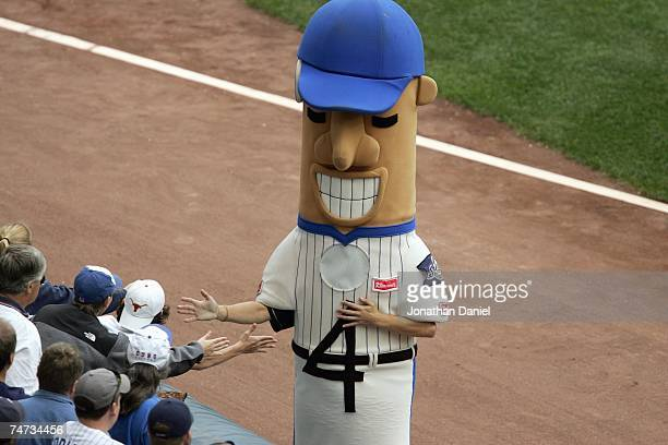Racing Sausages The Hot Dog of the Milwaukee Brewers greets fand before the game against the Chicago Cubs on June 6 2007 at Miller Park in Milwaukee...