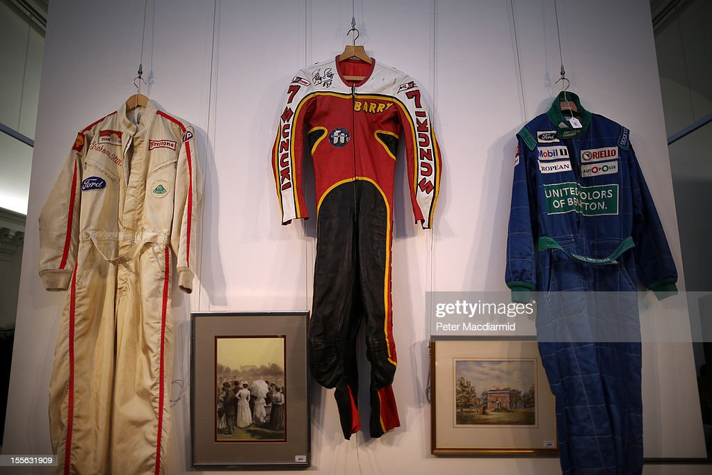 Racing suits worn by (L-R) Graham Hill, Barry Sheene and Nelson Piquet are displayed at Sotheby's on November 6, 2012 in London, England. Graham Budd auctioneers are holding a two day sale of Sporting Memorabilia at Sotheby's in London on 5-6th November 2012.