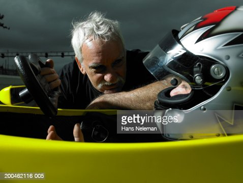 Racing team coach talking with Formula 1 driver : Stock Photo