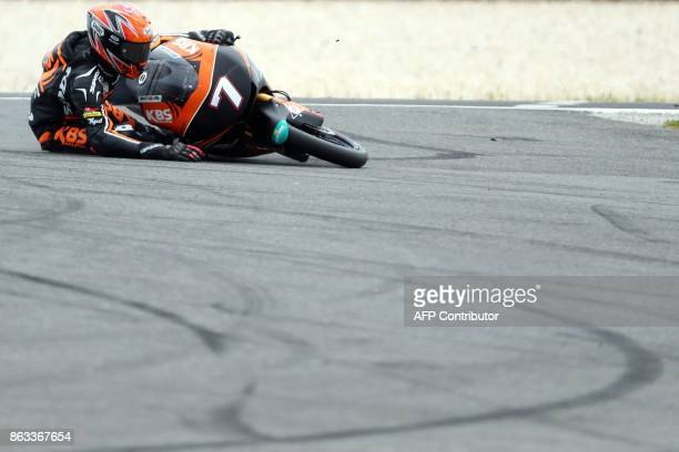 Racing team rider Adam Norrodin of Malaysia crashes during the Moto3 class second practice session of the Australian MotoGP Grand Prix at Phillip...