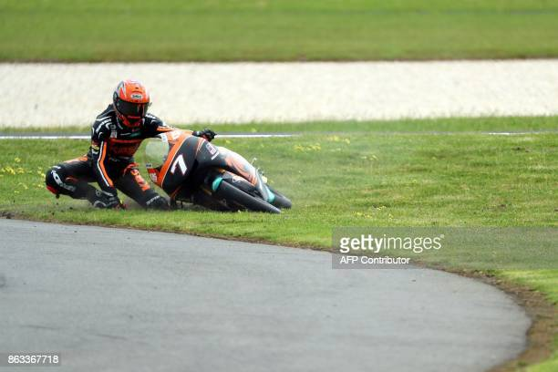 SIC Racing team rider Adam Norrodin of Malaysia crashes during the Moto3 class second practice session of the Australian MotoGP Grand Prix at Phillip...