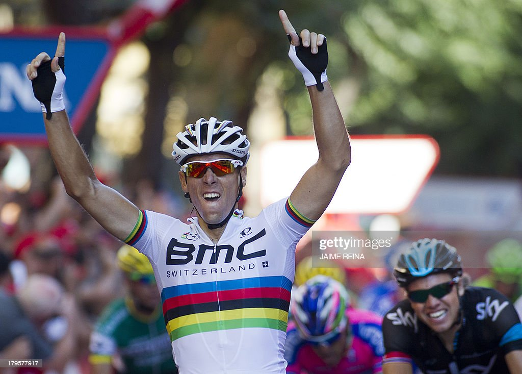 BMC Racing Team's Belgian rider Philippe Gilbert celebrates as he crosses the finish line of the 12th stage of the 68th edition of 'La Vuelta' Tour of Spain, a 164,2 kilometres stage between Maella and Tarragona, on September 5, 2013.