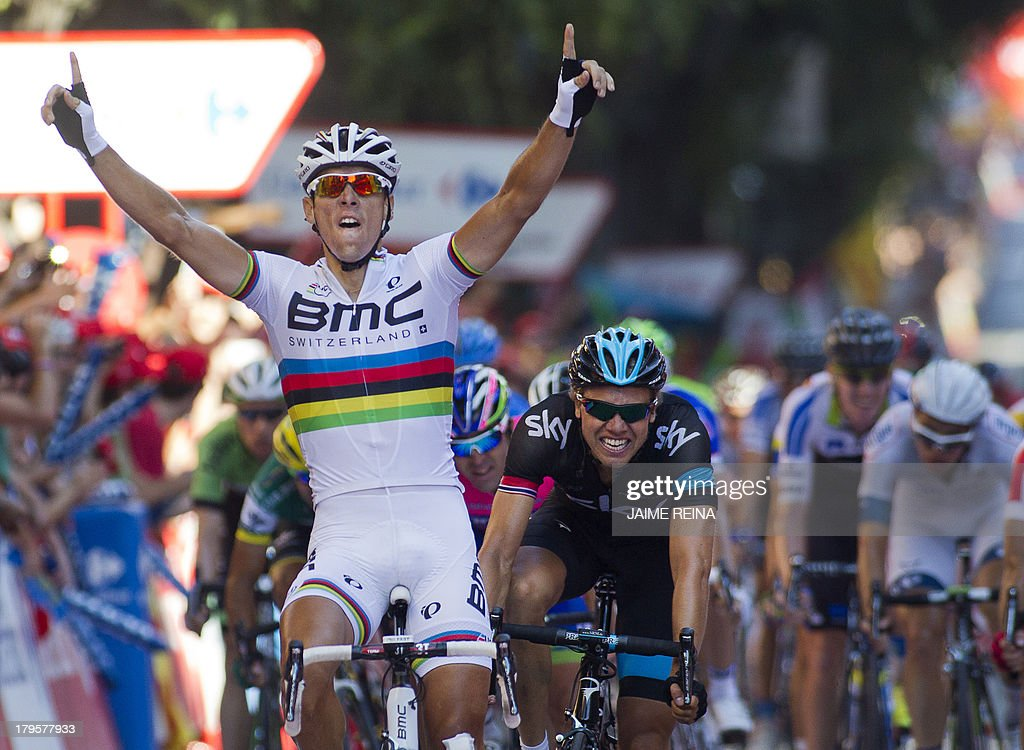 BMC Racing Team's Belgian rider Philippe Gilbert celebrates as he crosses the finish line of the 12th stage of the 68th edition of 'La Vuelta' Tour of Spain, a 164,2 kilometres stage between Maella and Tarragona, on September 5, 2013. AFP PHOTO/ JAIME REINA