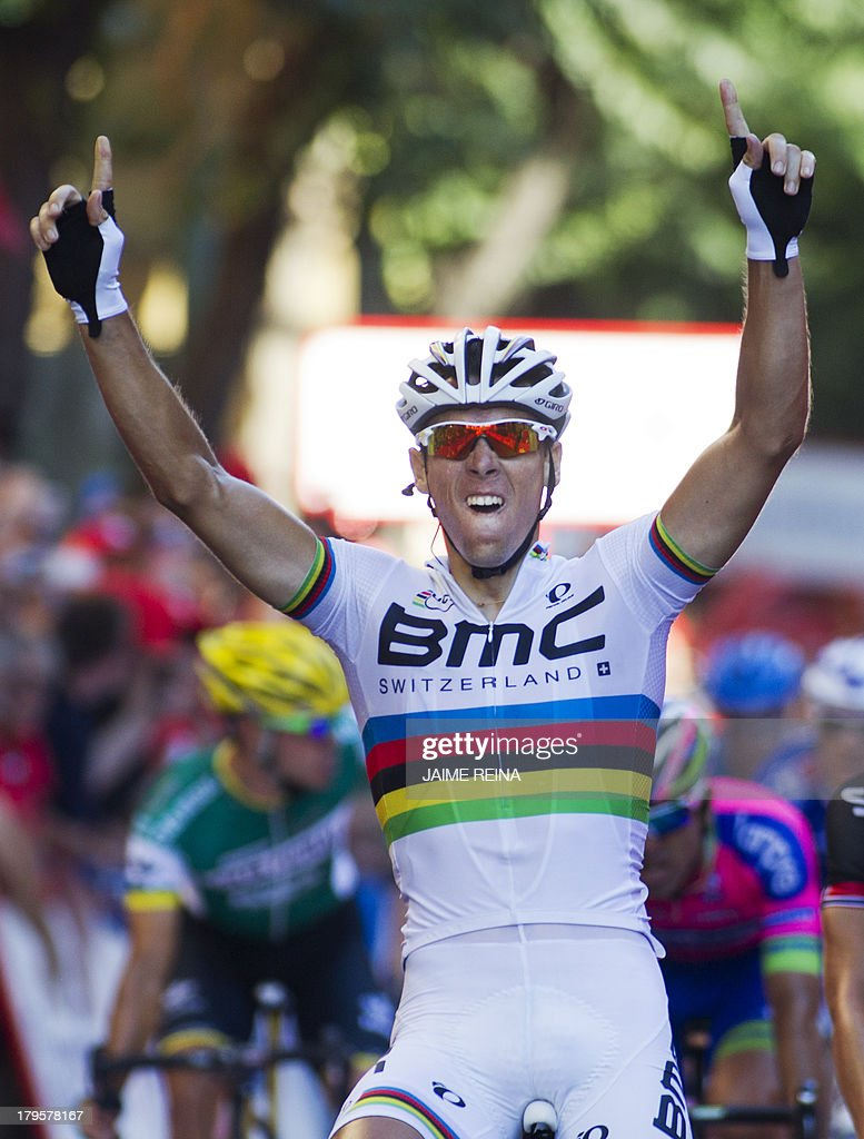 BMC Racing Team's Belgian rider Philippe Gilbert celebrates as he crosses the finish line to win the 12th stage of the 68th edition of 'La Vuelta' Tour of Spain, a 164,2 kilometres stage between Maella and Tarragona, on September 5, 2013. AFP PHOTO/ JAIME REINA