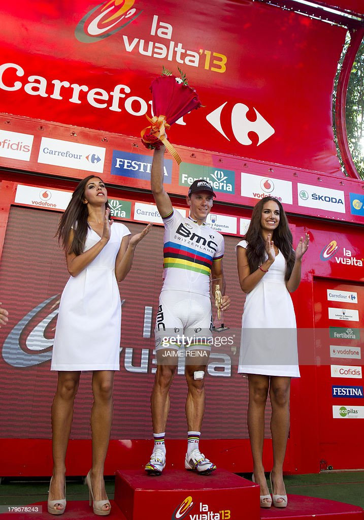 BMC Racing Team's Belgian rider Philippe Gilbert (C) celebrates on the podium after winning 12th stage of the 68th edition of 'La Vuelta' Tour of Spain, a 164,2 kilometres stage between Maella and Tarragona, on September 5, 2013.