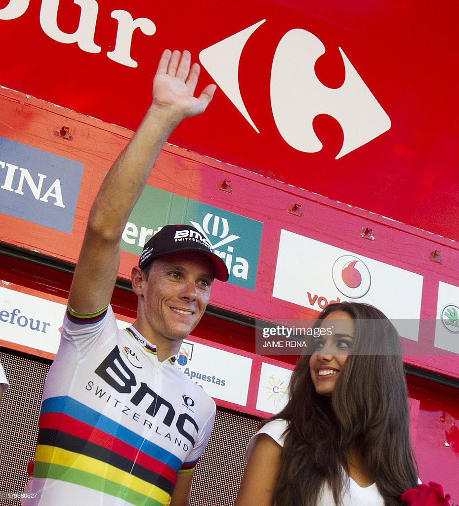 BMC Racing Team's Belgian rider Philippe Gilbert celebrates on the podium after winning 12th stage of the 68th edition of 'La Vuelta' Tour of Spain, a 164,2 kilometres stage between Maella and Tarragona, on September 5, 2013. AFP PHOTO/ JAIME REINA