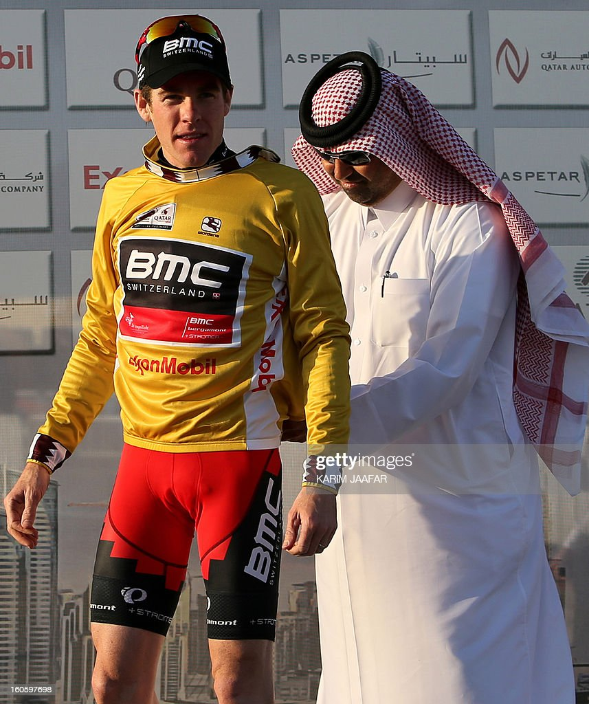 BMC Racing Team's Brent Bookwalter of the US (L) wears the leader's gold jersey after winning stage one of the 2013 Tour of Qatar from Katara Cultural Village in Doha to Dukhan Beach, west of the Qatari capital, on February 3, 2013.