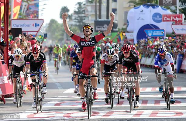 BMC Racing Team's Luxembourgian cyclist JeanPierre Drucker celebrates winning as he crosses the finish line during the 16th stage of the 71st edition...