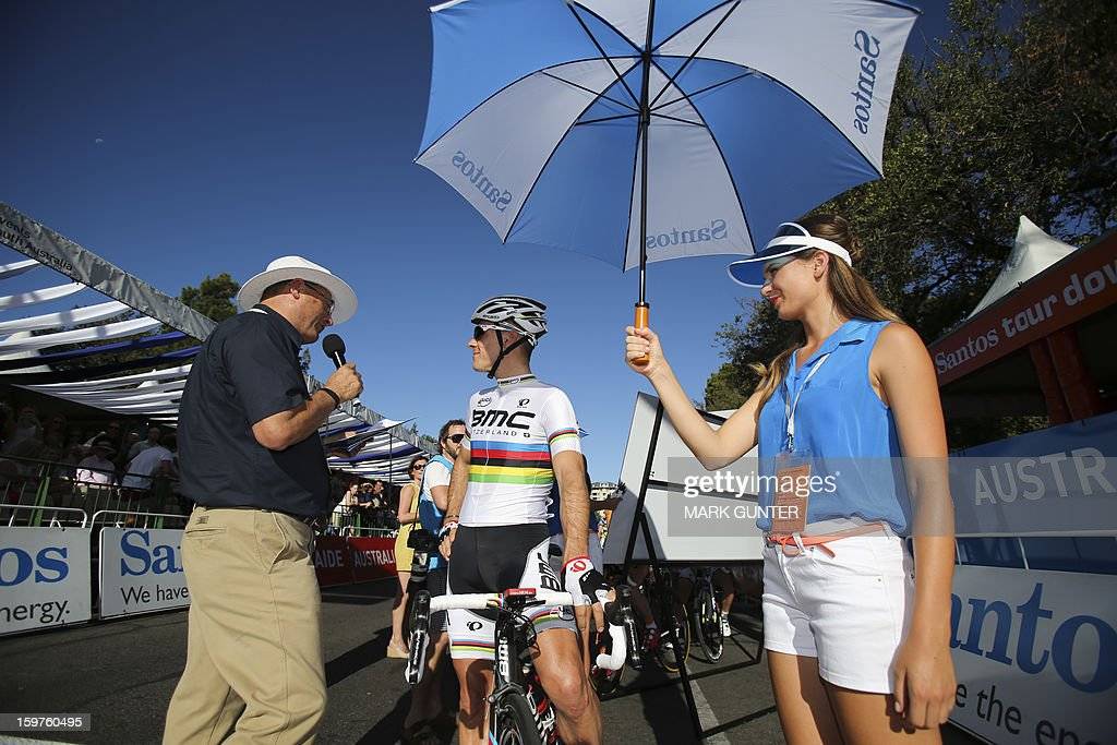 BMC Racing Team's Philippe Gilbert (C) of Belgium is interviewed before the start of the 51km People's Choice Classic prior to the Tour Down Under in Adelaide on January 20, 2013. The six-stage Tour Down Under takes place from January 20 to 27. AFP PHOTO / Mark Gunter USE