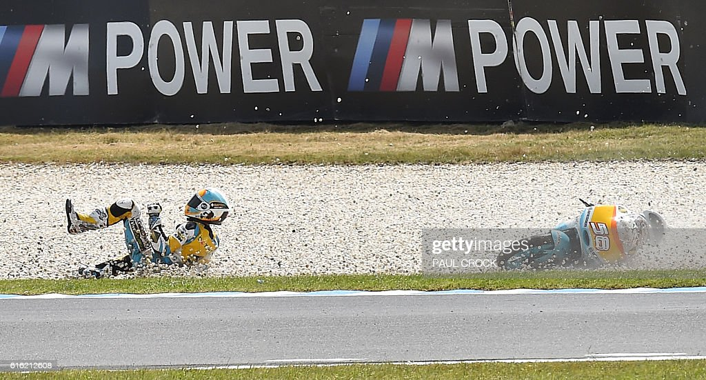 Racing Team's Spanish rider Juanfran Guevara crashes during the qualifying session of the Moto3 class at the Australian Grand Prix at Phillip Island on October 22, 2016. / AFP / PAUL