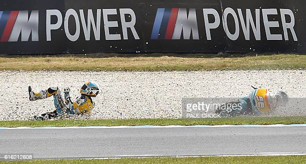 Racing Team's Spanish rider Juanfran Guevara crashes during the qualifying session of the Moto3 class at the Australian Grand Prix at Phillip Island...