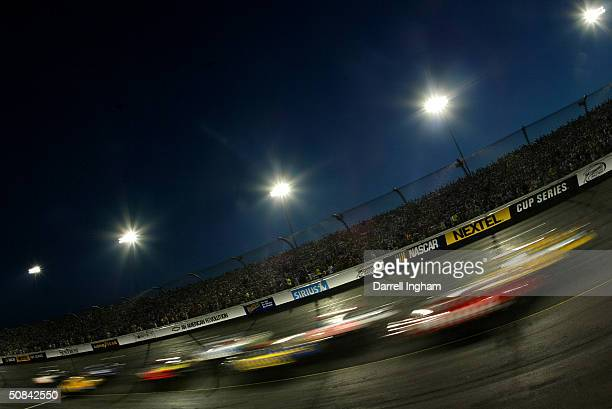 Racing under the lights on a Saturday night at the NASCAR Nextel Cup Series Chevy American Revolution 400 on May 15 2004 at Richmond International...