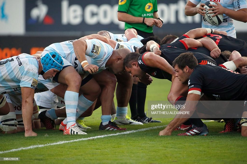 RacingMetro's 92 and Lyon's team fight for the ball during the French Top 14 Rugby Union match between Racing Metro 92 and Lyon on August 27 2016 at...