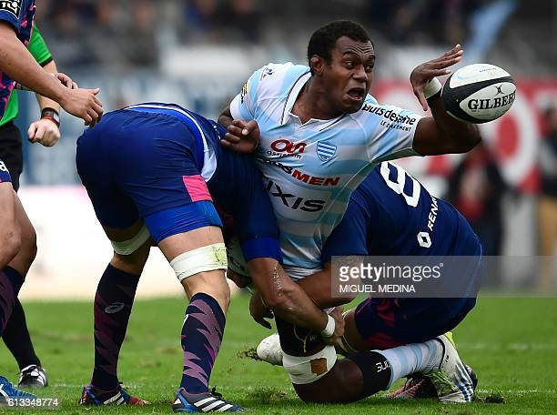TOPSHOT RacingMetro's Fijian second row Leone Nakarawa is tackled by Stade Francais' players during the French Top 14 rugby union match between...