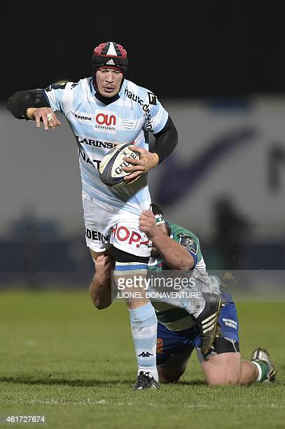 RacingMetro's flanker Wenceslas Lauret is tackled by Treviso's prop Matteo Zanusso on January 18 2015 during the European Champions Cup rugby union...