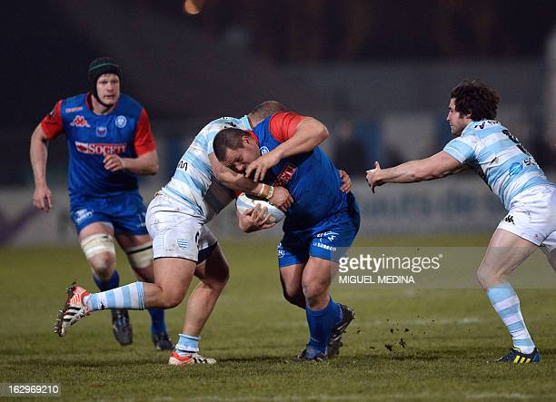 RacingMetro's prop Luc Ducalcon tackles Grenoble's Albertus Buckle during the French Top 14 rugby Union match Racing Metro 92 vs Grenoble on Mars 2...