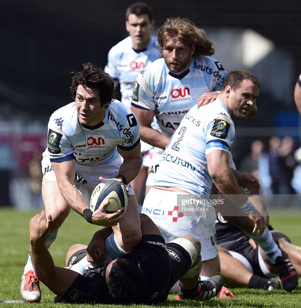 Racing-Metro's scrum half <a gi-track='captionPersonalityLinkClicked' href=/galleries/search?phrase=Maxime+Machenaud&family=editorial&specificpeople=7149115 ng-click='$event.stopPropagation()'>Maxime Machenaud</a> (L) is tackled by Saracens' prop <a gi-track='captionPersonalityLinkClicked' href=/galleries/search?phrase=Mako+Vunipola&family=editorial&specificpeople=4948128 ng-click='$event.stopPropagation()'>Mako Vunipola</a> during the European Champions Cup rugby union match Racing Metro 92 vs Saracens, on April 5, 2015, at the Yves-du-Manoir Stadium in Colombes, outside Paris. AFP PHOTO / FRANCK FIFE