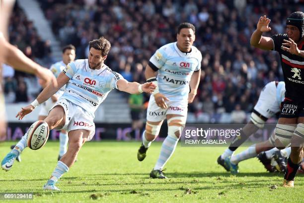 Racing's captain Maxime Machenaud kicks the ball during the French Top 14 rugby union match between Stade Toulousain and Racing 92 on April 16 2017...