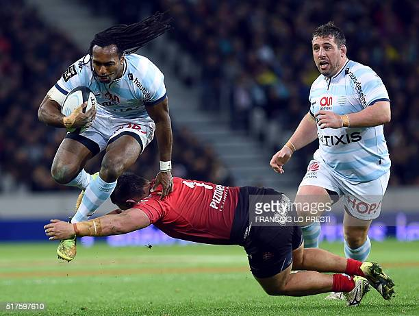 TOPSHOT Racing's Fijian centre Albert Vulivuli jumps to evade Toulon's French prop Alexandre Menini during the French Top 14 rugby union match...