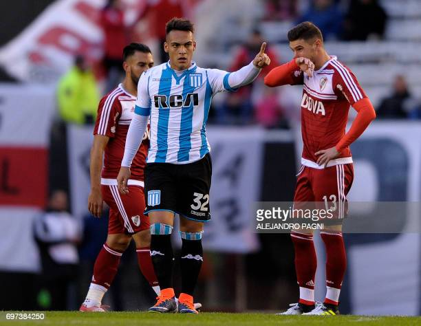 Racing's forward Lautaro Martinez celebrates after scoring against River Plate during their Argentina First Division football match at the Antonio...