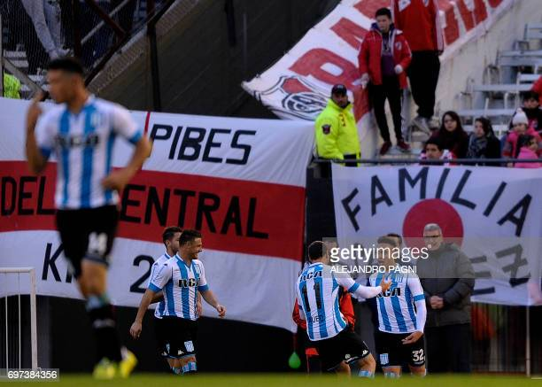 Racing's forward Lautaro Martinez celebrates with teammates after scoring against River Plate during their Argentina First Division football match at...