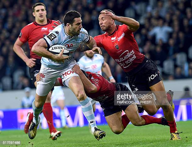 Racing's French flyhalf Remi Tales vies with Toulon's New Zealander's wing Tom Taylor during the French Top 14 rugby union match between Racing 92...