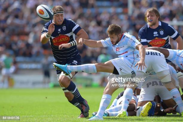 Racing's French scrumhalf Teddy Iribaren clears a ball during the French Top 14 rugby union match between Agen and Racing 92 on September 2 2017 at...