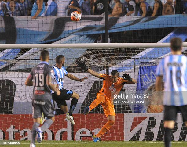 Racing's Lisandro Lopez scores his team's first goal against Bolivar during their Copa Libertadores 2016 group 3 football match at Presidente Peron...