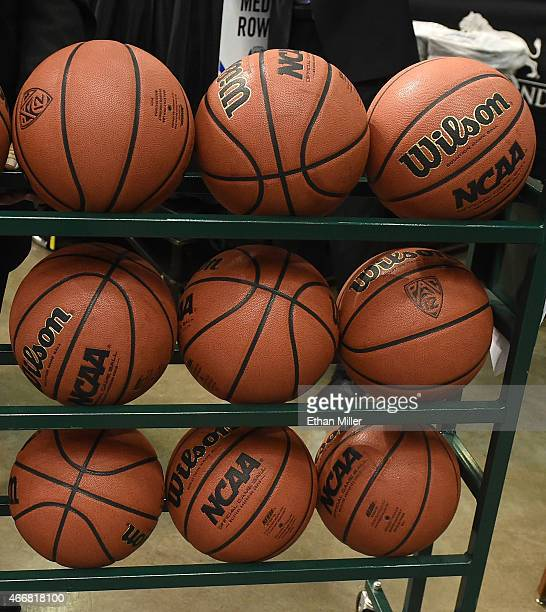 A rack of basketballs is removed from the court before a quarterfinal game of the Pac12 Basketball Tournament between the California Golden Bears and...
