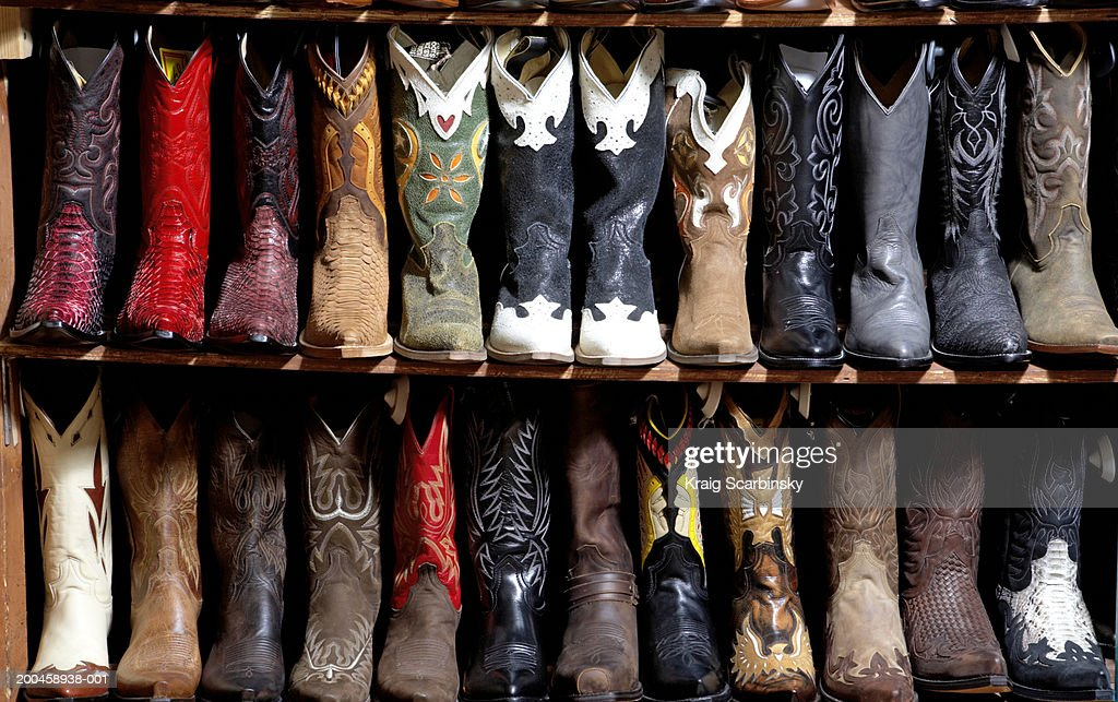 Rack of cowboy boots in shoe store, full frame : Stock Photo