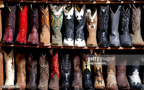 Rack of cowboy boots in shoe store, full frame