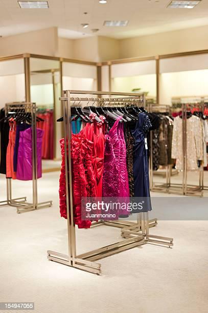 A rack of designer formal dresses in a high-end boutique.