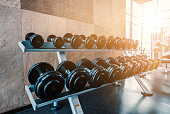 Rack of Dumbbell in fitness room at the morning