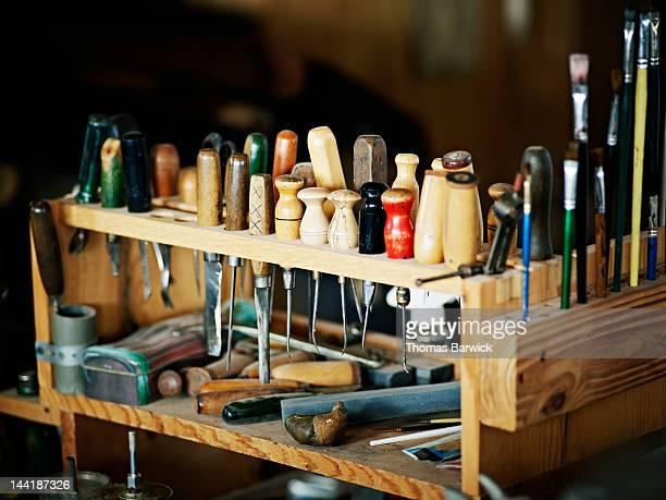 Rack of hand tools in boot shop