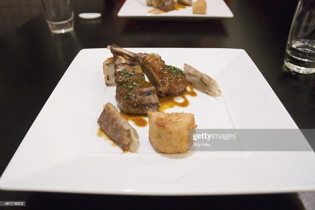 Rack of lamb with gyoza dumplings and potato : Stock Photo