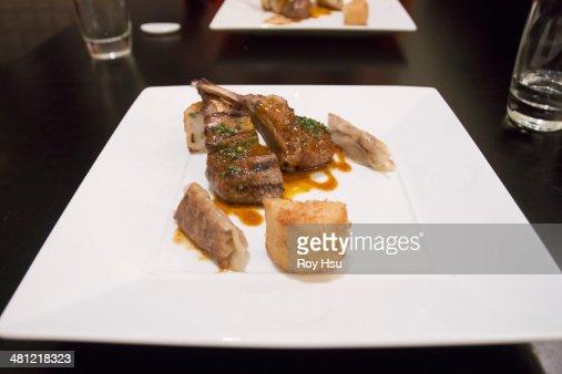 Rack of lamb with gyoza dumplings and potato : Stock Photo