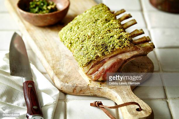 Rack of lamb with herb crust on chopping board