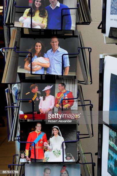 A rack of postcards at a souvenir shop in London England features postcards with photographs of Prince William and Kate Middleton the Duke and...
