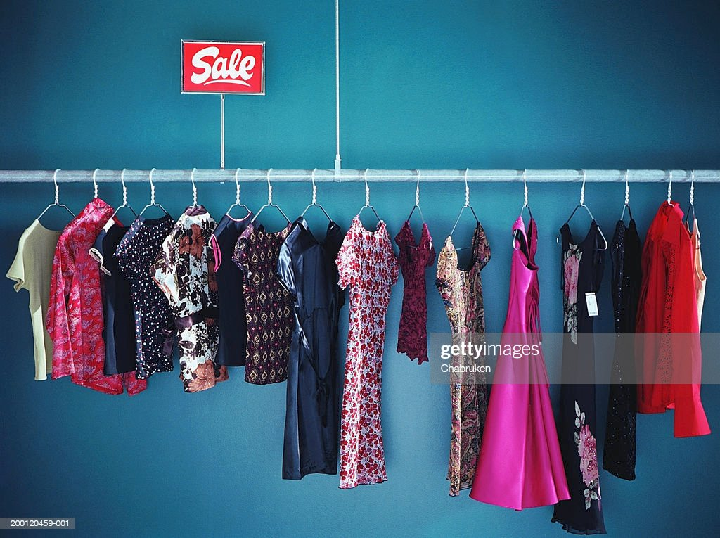 Rack of  women's clothes with sale sign in store : Stock Photo