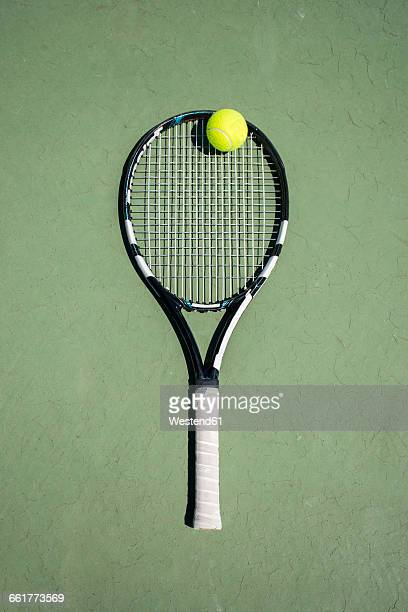 Racket and ball on a tennis court