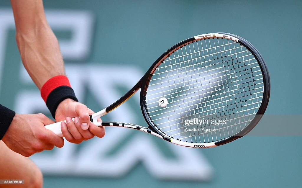 Racket of Novak Djokovic is seen as he plays against Steve Darcis (not seen) of Belgium during their men's single second round match at the French Open tennis tournament at Roland Garros in Paris, France on May 26, 2016.